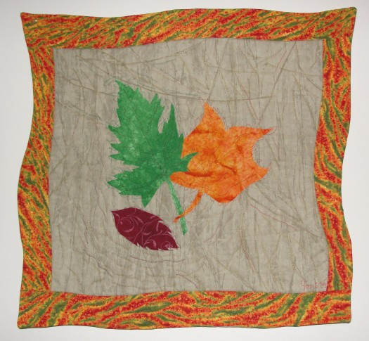 "First Colors of Autumn #1, rayon on cotton, 20""x 20"", © 2009 Joni Beach. Fused-applique and free-motion quilting."