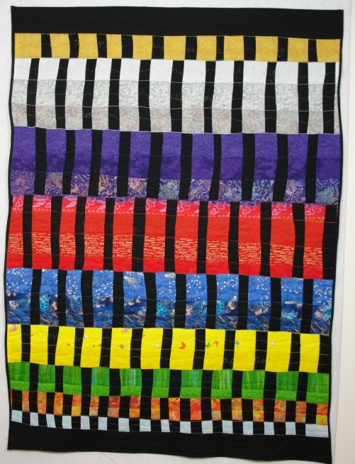 """Lifeweaving #3: 9 Stages of Life,  59"""" x 45"""", rayon and metallic on cotton. Woven fabric strips, machine and free-motion quilting. (c) 2014 Joni Beach. ($2400)"""